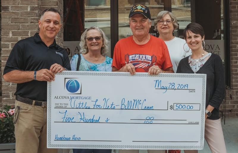 bill mccann accepting hometown heroes award