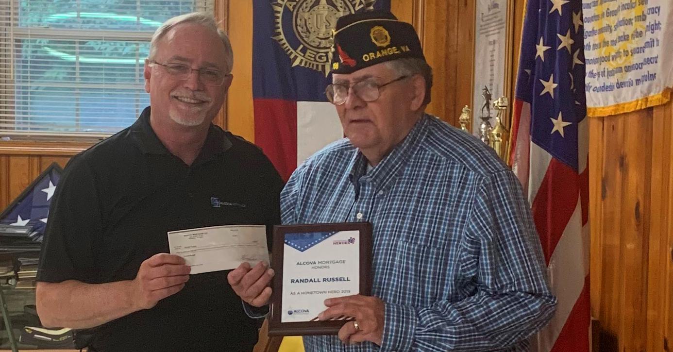 randall russell receiving his hometown hero award